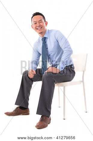 Full body Asian business man sitting on a chair over white background