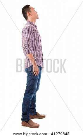 Side view full body Chinese Asian male standing looking up isolated on white background