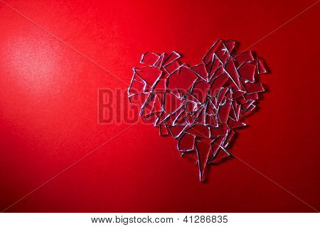 Broken Glass Heart On Red Background