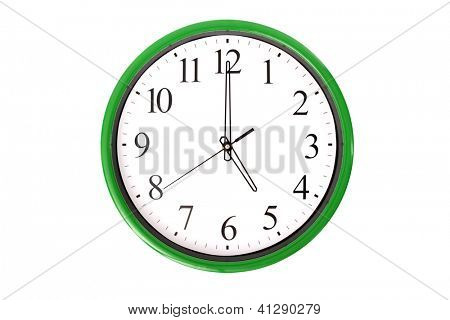 A clock from a serie showing 5 o'clock. Isolated on a white background.