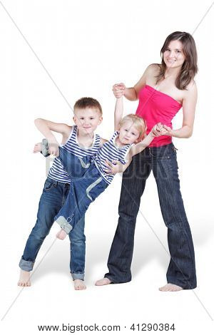 Smiling mother and her eldest son hold his younger brother by his arms and legs