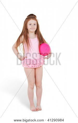Little red-haired girl in pink swimsuit with ball under her arm
