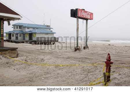 SEASIDE HEIGHTS, NJ - JAN 13:The Coca Cola sign and comfort station in the fog on January 13, 2013 in Seaside Heights, New Jersey. Clean up continues 75 days after Hurricane Sandy hit in October 2012.