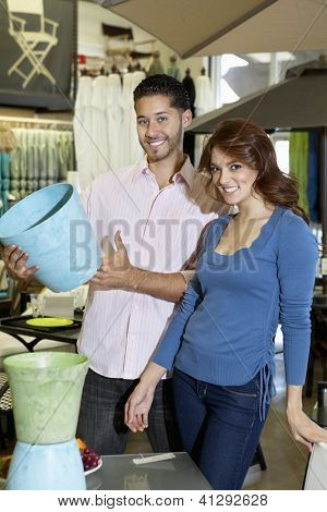 Portrait of young couple with a souvenir in store