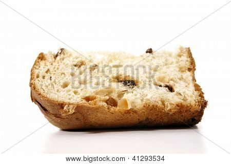 A delicious panettone slice isolated on white background for christmas