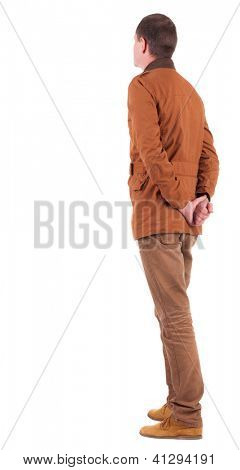 Back view of Pensive stylish man in a brown jacket.   Standing young guy in jeans and  jacket. Rear view people collection.  backside view of person.  Isolated over white background.