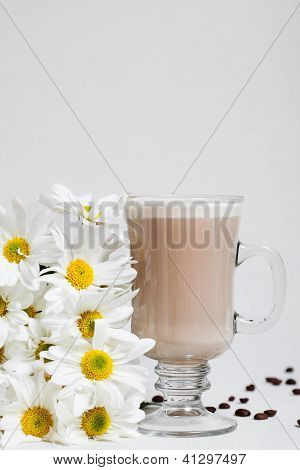 Cup of Cappuccino with cinnamon and White Flowers