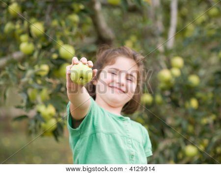Girl Showing Apple