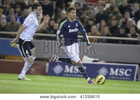 VALENCIA - JANUARY 20: Cristiano Ronaldo with ball and Rami during Spanish Soccer League match between Valencia CF and Real Madrid, on January 20, 2013, in Mestalla Stadium, Valencia, Spain