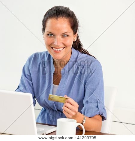 Smiling woman paying bills online banking home credit card consumerism