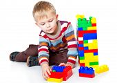 stock photo of little boys only  - a funny boy is playing with lego - JPG