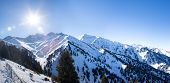 image of snowy hill  - Panorama of Winter Snowy Mountains valley with sun in Ak Bulak Almaty Kazakhstan Asia - JPG