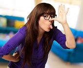 stock photo of crazy face  - Crazy Woman With Stick Out Tongue - JPG