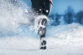 picture of cold-weather  - Athlete woman is running during winter training outside in cold snow weather.