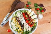 stock photo of romaine lettuce  - Colorful hearty entree sized cobb salad with bacon - JPG