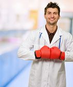 pic of boxing day  - Young Doctor Wearing Boxing Gloves With Hands Together - JPG