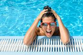 stock photo of crazy face  - Young beautiful crazy woman in fresh swimming pool of resort - JPG