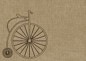 image of penny-farthing  - Penny Farthing bicycle on brown textured background - JPG
