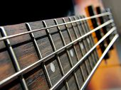 stock photo of rock star  - macro shoot of rock bass guitar - JPG