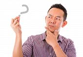 image of guess  - Asian man hand holding blank sign with unsure face expression - JPG