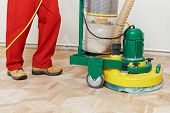 pic of wood craft  - carpenter doing parquet Wood Floor polishing maintenance work by grinding machine - JPG