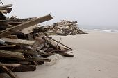 SEASIDE HEIGHTS, NJ - JAN 13: Wooden planks piled up on the beach on January 13, 2013 in Seaside Hei