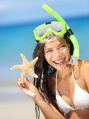 foto of watersports  - Summer beach vacation holidays woman wearing snorkeling mask showing star happy joyful and laughing - JPG