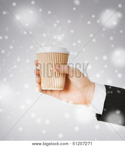 fast food concept - man hand holding take away coffee cup