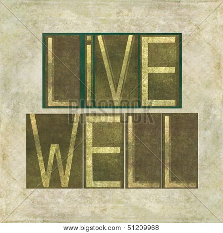 "Earthy background image and design element depicting the words ""Live well"""