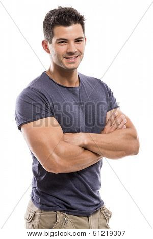 Portrait of a handsome and athletic latin man smiling with hands folded, isolated over a white background