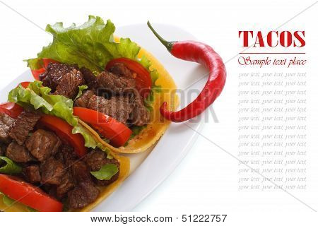 Mexican tacos with chili peppers isolated on a white