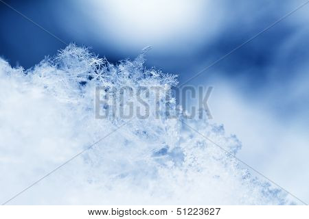 Snowflake In Blue Snow