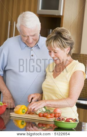 Husband And Wife Preparing Vegetables