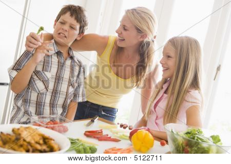 Mother And Children Prepare A Meal, Mealtime Together