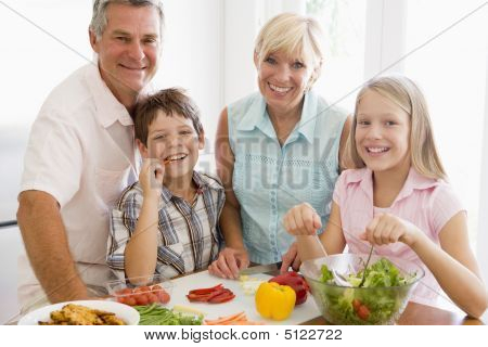 Grandparents And Grandchildren Prepare A Meal, Mealtime Together