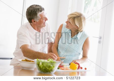 Husband And Wife Preparing Meal, Mealtime Together