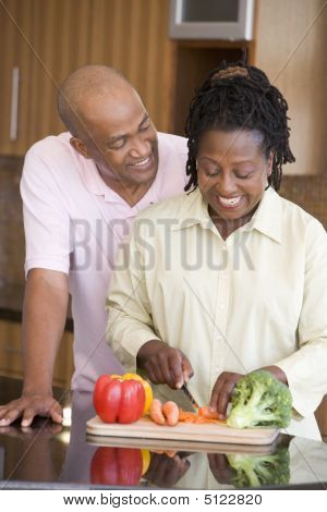 Husband And Wife Preparing A Meal, Mealtime Together