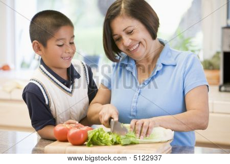 Grandmother And Grandson Preparing Meal, Mealtime Together