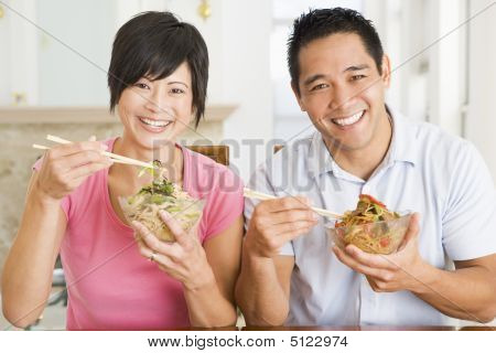 Young Couple Enjoying Chinese Food