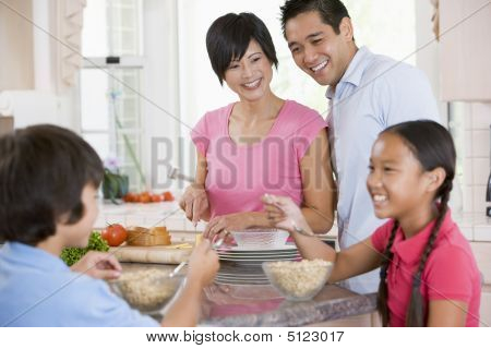 Family In Kitchen Eating Breakfast