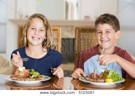 Brother And Sister Eating Meal, Mealtime Together