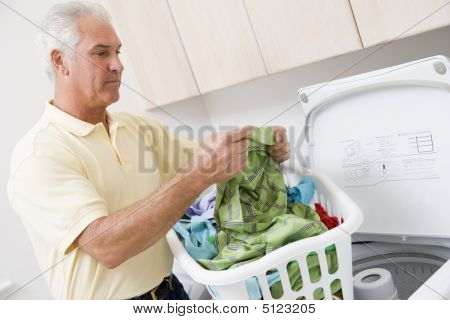 Man Reading Washing Instructions