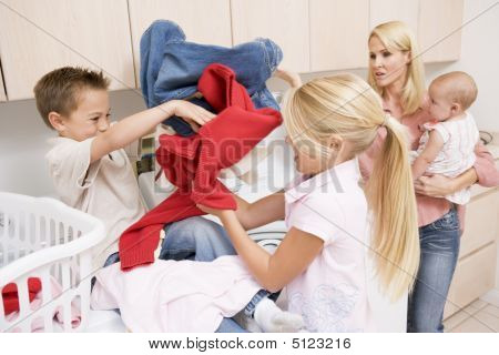 Siblings Fighting While Doing Laundry