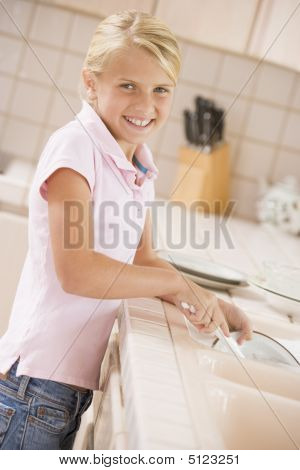 Young Girl Cleaning Dishes,