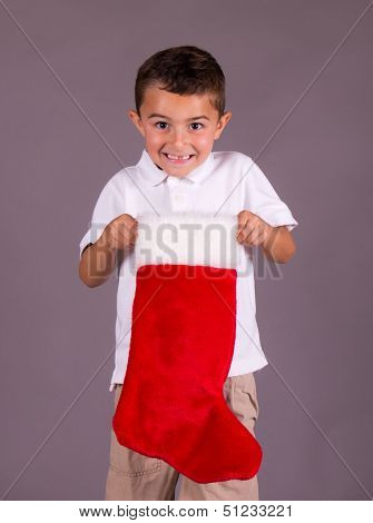 Little Boy Happy With Christmas Stocking