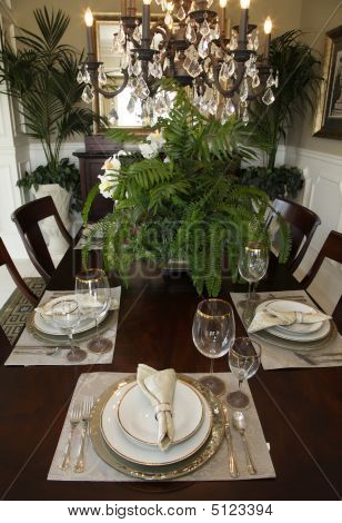 Dining Table With Modern Tableware.
