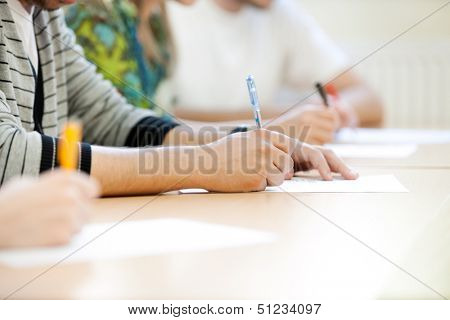 students make notes, close up of hands