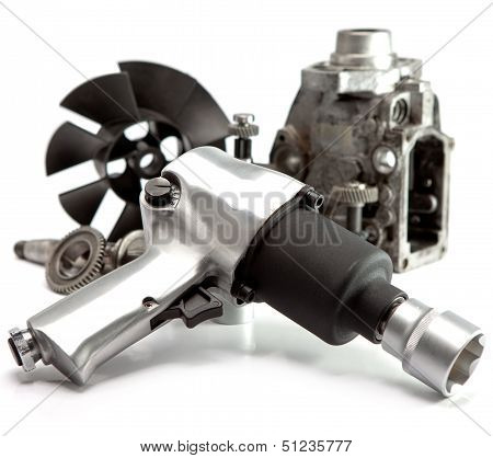 Car repair - details of the pump of high pressure and air impact wrench on white background