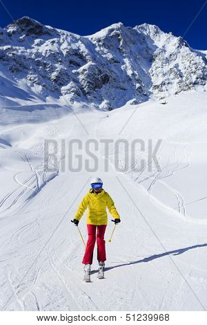 Ski, skier, winter sport - woman skiing downhill