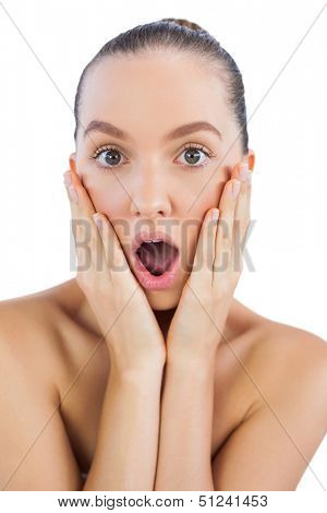 Pretty model with astonished face looking at camera
